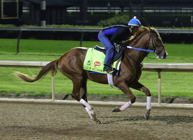 Exercise rider Carlos Rosas takes Kentucky Derby entrant Gun Runner for a morning workout at Churchill Downs Friday, May 6, 2016, in Louisville, Ky. The 142nd running of the Kentucky Derby is sche ...