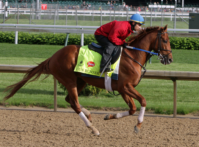 Kentucky Derby entrant Gun Runner, ridden by exercise rider Carlos Rosas, works out at Churchill Downs in Louisville, Ky., Thursday, May 5, 2016. The 142nd Kentucky Derby is Saturday, May 7. (Garr ...