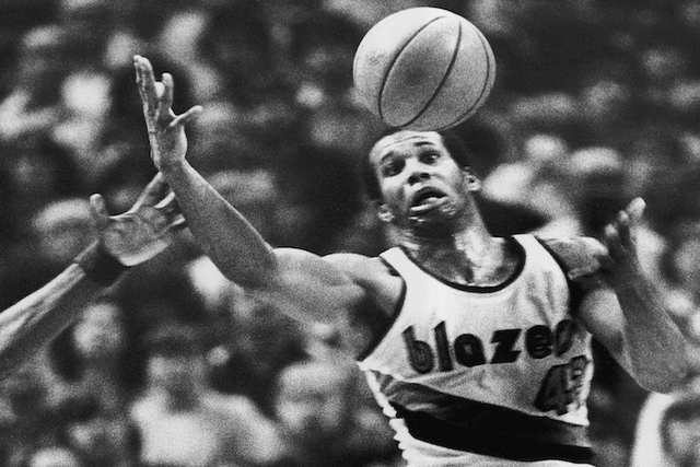 Portland Trail Blazers'  Kermit Washington gains control of a loose ball during an NBA basketball game against the Golden State Warriors in Portland, Ore. Washington. (Jack Smith/AP)
