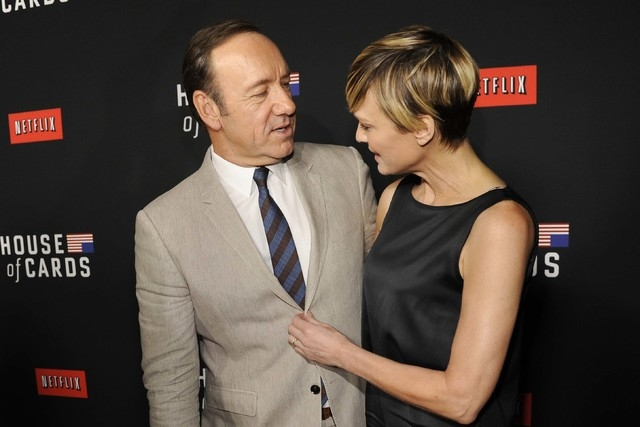 "Kevin Spacey and Robin Wright arrive at a special screening for season 2 of ""House of Cards"" in Los Angeles, Feb. 13, 2014. (Chris Pizzello/Invision/AP)"