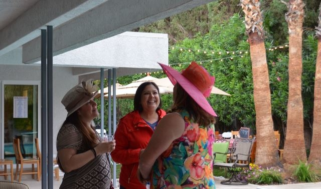 Mac King's wife, Jennifer, right, chats with neighbors Bethany Stone, left, and Connie Kellers at Mac King's 16th Kentucky Derby Party May 7, 2016. Ginger Meurer/Special to View
