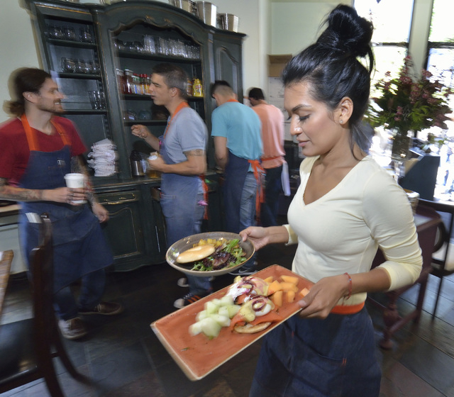 server ilse sepulveda takes orders to customers at kitchen table at 1716 w horizon ridge - Kitchen Table Review