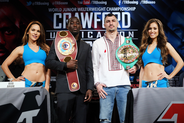 Junior welterweight champions Terence Crawford, left, and Viktor Postol hold a press conference at the Beverly Hills Hilton Hotel on Tuesday afternoon to announce their unification bout which will ...