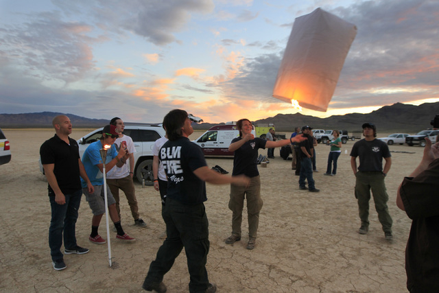 Alan Dabash and Kendra Jackson join other public lands officials and event organizers as they fill paper lanterns with heat to test them and their environmental impact in advance of the RiSE Festi ...