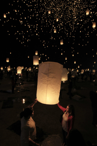 Paper lanterns are released and float to the sky at the RiSE Festival Saturday, Oct. 18, 2014 on a dry lake bed near Jean.  (Sam Morris/Las Vegas Review-Journal)