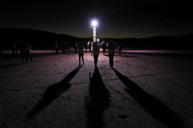 Participants make their way to the RiSE Festival Saturday, Oct. 18, 2014 on a dry lake bed near Jean.  (Sam Morris/Las Vegas Review-Journal)