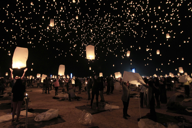 Paper lanterns are released and float to the sky at the RiSE Festival Saturday Oct & Tickets for RiSE Lantern Festival north of Las Vegas go on sale ... azcodes.com