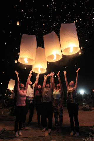 A group releases their paper lanterns at the RiSE Festival Saturday, Oct. 18, 2014 on a dry lake bed near Jean.  (Sam Morris/Las Vegas Review-Journal)