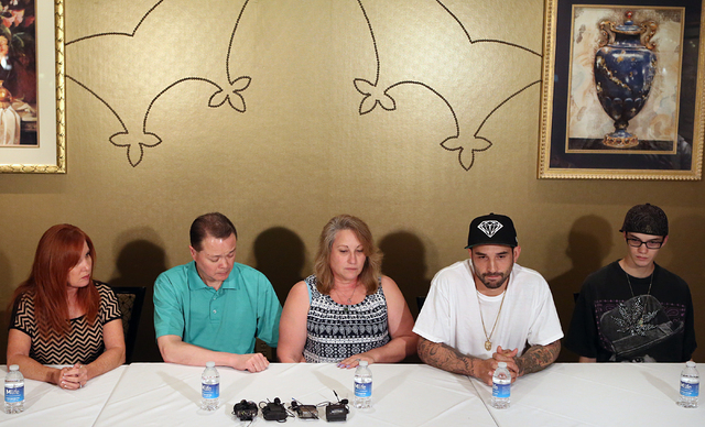 Lee's Discount Liquor robbery victim Matthew Christensen's father, Dennis, second left, his mother, Theresa, center, his brother Reggie and his younger brother Curtis, right, talk about their loss ...