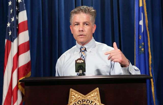 Metro Lt. Dan McGrath talks about the recent arrests in the Lee's Discount Liquor homicide at a news conference on Wednesday, May 4, 2016, at Las Vegas police headquarters. The suspects, Ray Charl ...