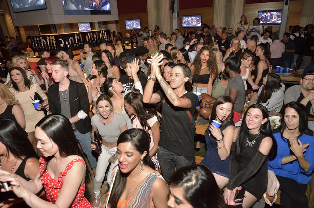 "The crowd is shown during a lip sync battle between the men of ""Chippendales"" and the women of ""Crazy Girls"" at the Beer Park in the Paris hotel-casino at 3655  ..."