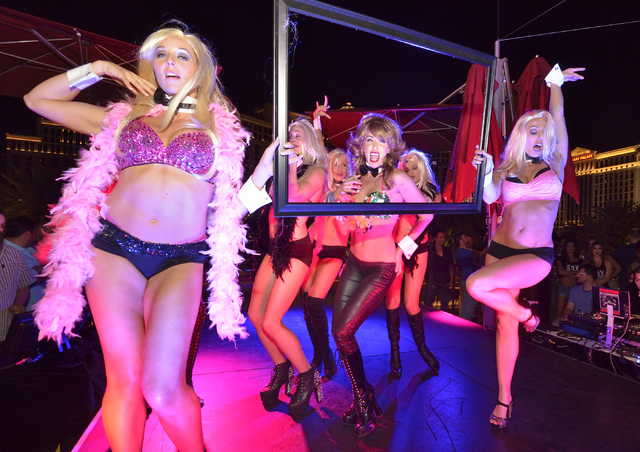 "Cast members from ""Crazy Girls"" perform during a lip sync contest against the men of ""Chippendales"" at the Beer Park in the Paris hotel-casino. (Bill Hughes/Las Vegas Review-Journal)"