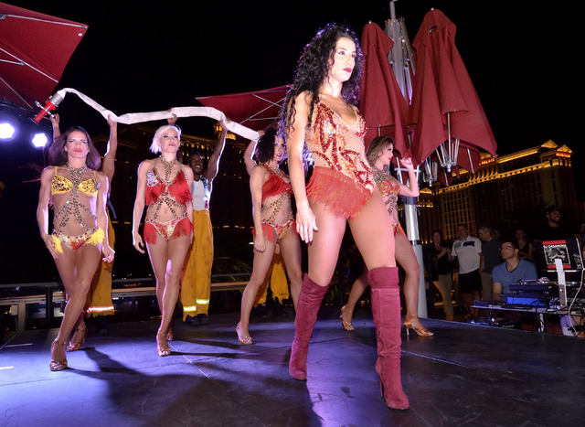 "Cast members from ""53X"" perform during a break in the action in a lip sync contest between the women of ""Crazy Girls"" and the men of ""Chippendales"" at the Beer Park in the Paris hotel-casino. (Bil ..."