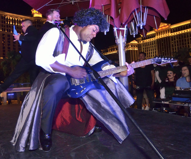 "Staceyy (cq) Robinson of ""Chippendales"" performs as Prince during a lip sync battle against the women of ""Crazy Girls"" at the Beer Park in the Paris hotel-casin ..."