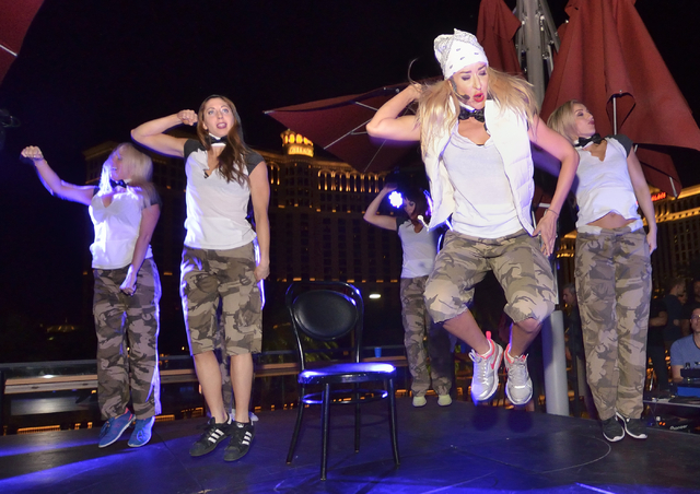 "Cast members from ""Crazy Girls"" perform during a lip sync battle against the men of ""Chippendales"" at the Beer Park in the Paris hotel-casino. (Bill Hughes/Las Vegas Review-Journal)"