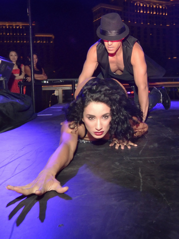 "Patricia Bouchebel, assistant choreographer and dancer for ""53X"" and Enrique Lugo, choreographer, perform during a break in the action in a lip sync contest at the Beer Park in the Paris hotel-cas ..."