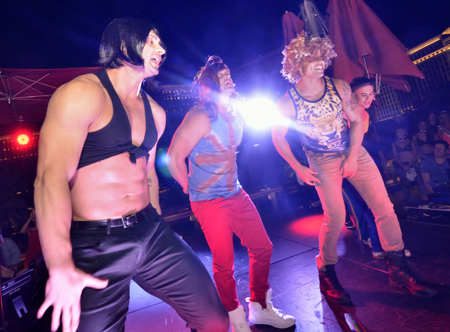 "The men of ""Chippendales"" take part in a lip sync contest against the women of ""Crazy Girls"" at the Beer Park in the Paris hotel-casino. (Bill Hughes/Las Vegas Review-Journal)"