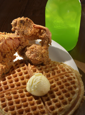The #3 Lo-Lo's, featuring three pieces of chicken and two waffles topped with butter, is shown with green apple Kool-Aid at Lo-Lo's Chicken and Waffles at 2040 N. Rainbow Blvd. in La ...