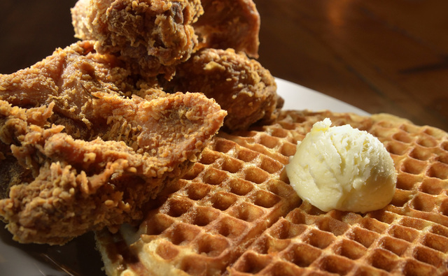 The #3 Lo-Lo's, featuring three pieces of chicken and two waffles topped with butter, is shown at Lo-Lo's Chicken and Waffles at 2040 N. Rainbow Blvd. in Las Vegas on Saturday, May 1 ...