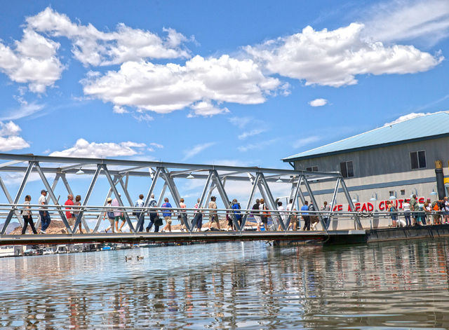 Customers on Lake Mead Cruises walk across the bridge towards their boat at Lake Mead National Recreation Area, Wednesday, May 18, 2016, in Boulder City, Nevada. Benjamin Hager/Las Vegas Review-Jo ...