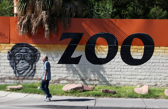 A man walks by the Southern Nevada Zoological Park on Rancho Drive. (Justin Yurkanin/Las Vegas Review-Journal)