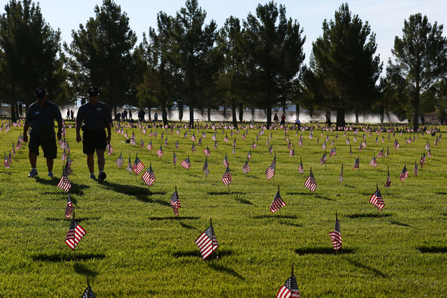 More than 26,000 flags were placed in less than an hour part of the 26th annual placement of flags at Southern Nevada Veterans Memorial Cemetery in Boulder City, Nev. on May 28, 2016. Bridget Benn ...