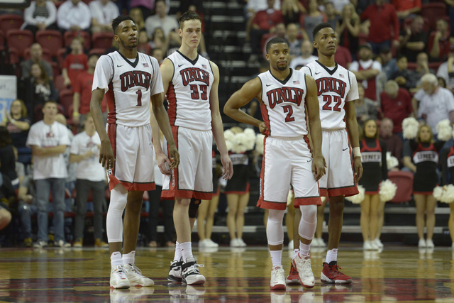 From left, UNLV forward Derrick Jones Jr., forward Stephen Zimmerman Jr., guard Jerome Seagears and guard Patrick McCaw wait at halfcourt for a free throw attempt during a Mountain West game again ...