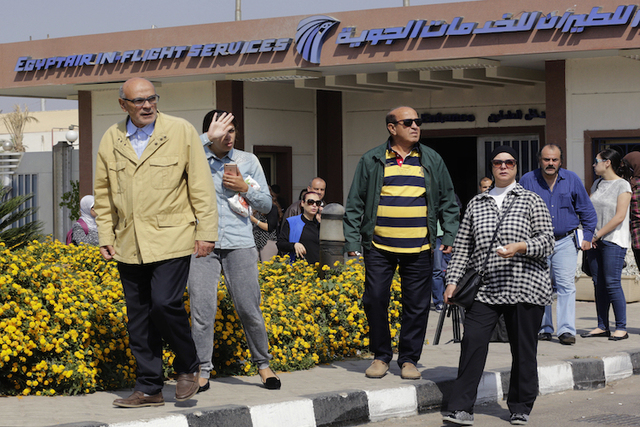 Relatives leave the Egyptair in-flight service building where they were held at Cairo International Airport, Egypt, Thursday, May 19, 2016. An EgyptAir flight from Paris to Cairo carrying 66 peopl ...