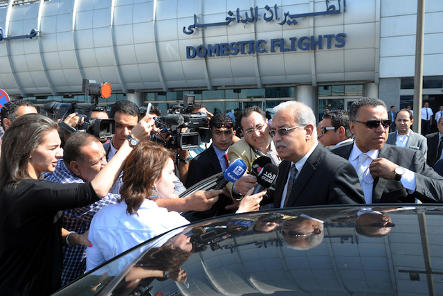 Egyptian Prime Minister Sherif Ismail talks to reporters at Cairo International Airport, Thursday, May 19, 2016.  (Selman Elotefy/AP)