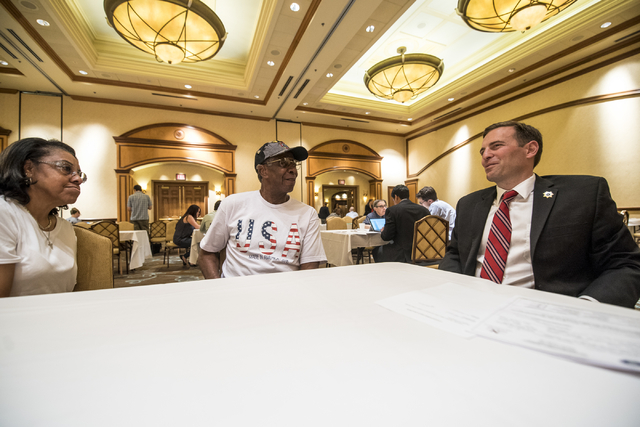 Adam Laxalt, Nevada attorney general, right, works with James Dorsey and Doris Haynes and assists them with their will during a military appreciation event at the Texas Station hotel-casino in Las ...