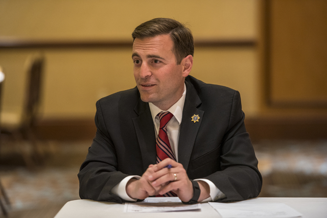 Adam Laxalt, Nevada attorney general, works with military families with legal issues during a military appreciation event at the Texas Station hotel-casino in Las Vegas on Monday, May 23, 2016. (J ...