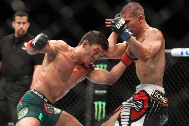 Joseph Benavidez hits John Moraga with a left during their fight at UFC 187 Saturday, May 23, 2015, at the MGM Grand Garden Arena. Benevidez won by unanimous decision. (Sam Morris/Las Vegas Review ...