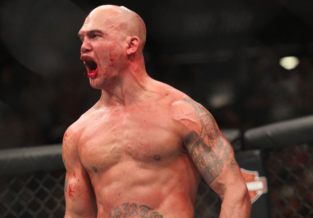 Robbie Lawler celebrates his win over Rory MacDonald during their welterweight title bout at UFC 189 at the MGM Grand Garden Arena Saturday, July 11, 2015, in Las Vegas. Lawler won by technical kn ...