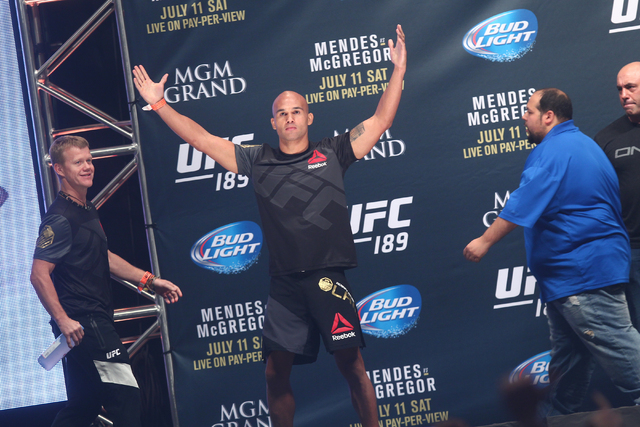 Robbie Lawler acknowledges the crowd before standing on the scale during the final weigh-in for his welterweight bout against Rory MacDonald in UFC 189, slated to take place Saturday night, at the ...