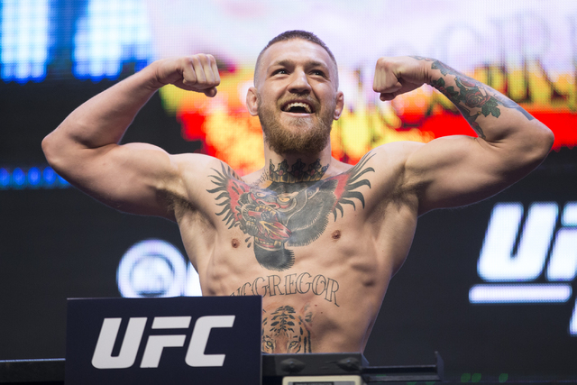 UFC fighter Conor McGregor poses during his weigh-in for UFC 196 at the MGM Grand Garden Arena on Friday, March 4, 2016, in Las Vegas.McGregor will fight Nate Diaz Saturday in a title bout. (Erik  ...