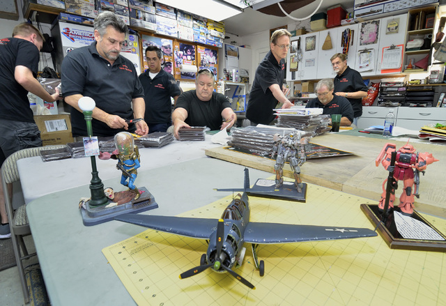Members of the Las Vegas chapter of the International Plastic Modelers Society put together plaques to be awarded at the Best of the West VegasCon 2016 on May 7 during a meeting at the home of soc ...