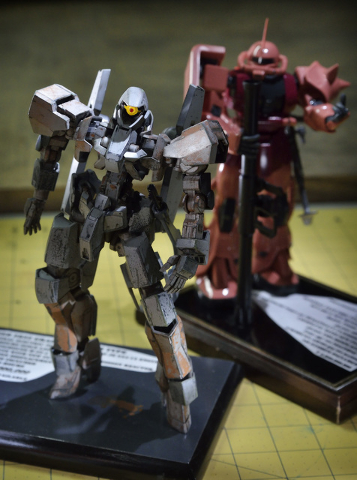 A pair of Gundams based on Japanese anime built by Joe Porche are shown during a meeting of the Las Vegas chapter of the International Plastic Modelers Society at his home in Las Vegas on Wednesda ...