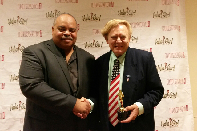 """Prather Jackson, left, president of the Hollywood Weekly magazine Film Festival, presents the Honorable Mention Award to Chuck N. Baker for his documentary """"Veterans: A Motion Picture."""" L.F.Guiffr ..."""