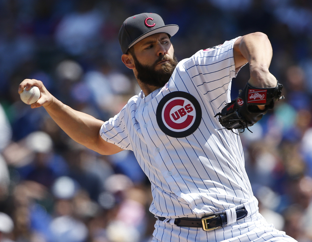 Chicago Cubs starter Jake Arrieta throws against the Washington Nationals during the first inning of a baseball game Sunday, May 8, 2016, in Chicago. (Nam Y. Huh/AP)