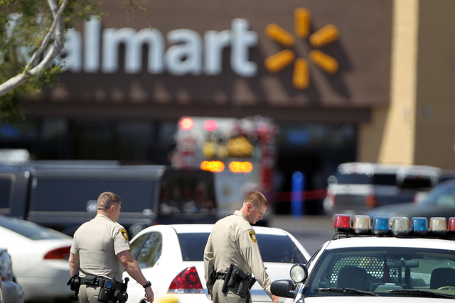 Las Vegas police and firefighters appear outside a Walmart after shootings left five people dead -- including two Las Vegas police officers -- at the store and a nearby CiCiճ Pizza at the corner  ...