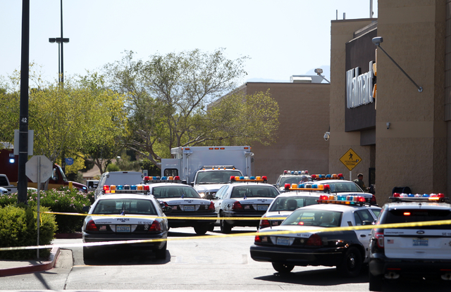 Las Vegas police and firefighters appear outside a Walmart after shootings left five people dead -- including two Las Vegas police officers -- at the store and a nearby CiCi's Pizza at the corner  ...