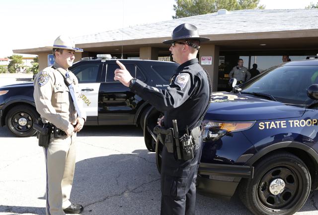 California Highway Patrol trooper Ryan Camara, left, and Nevada Highway Patrol trooper Jason Buratczuk chat outside the NHP substation in Jean on Friday, May 27, 2016. The Nevada Highway Patrol an ...