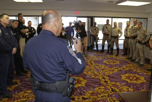 Sgt. Charles Lee of Nevada Highway Patrol speaks during a briefing inside the NHP substation in Jean on Friday, May 27, 2016. The Nevada Highway Patrol and California Highway Patrol joined forces  ...