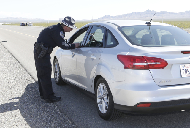 Nevada Highway Patrol trooper Jason Buratczuk talks to a driver who was pulled over for speeding on I-15 North in Jean on Friday, May 27, 2016. The Nevada Highway Patrol and California Highway Pat ...