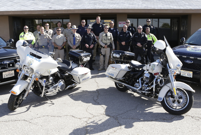 California Highway Patrol troopers, Nevada Highway Patrol troopers, Henderson and Metro Police officers pose for a photo outside the NHP substation in Jean on Friday, May 27, 2016. (Bizuayehu Tesf ...
