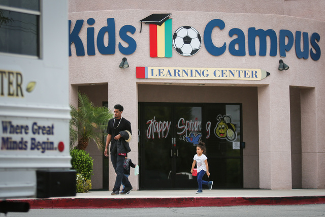 Deland France, 26, walks out of Kids Campus Learning Center with his daughters, aged three and four, in North Las Vegas on Friday, May 6, 2016. On Thursday, police say Travis Spitler shot and kill ...