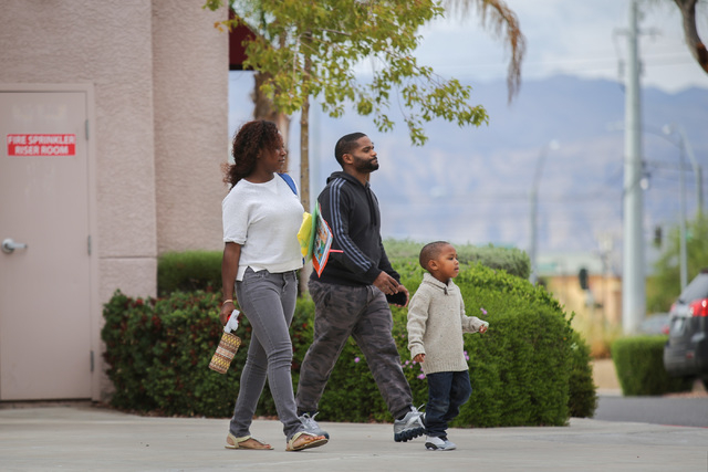 A family walks out of Kids Campus Learning Center in North Las Vegas on Friday, May 6, 2016. On Thursday, police say Travis Spitler shot and killed his ex-girlfriend Christina Franklin and shot at ...