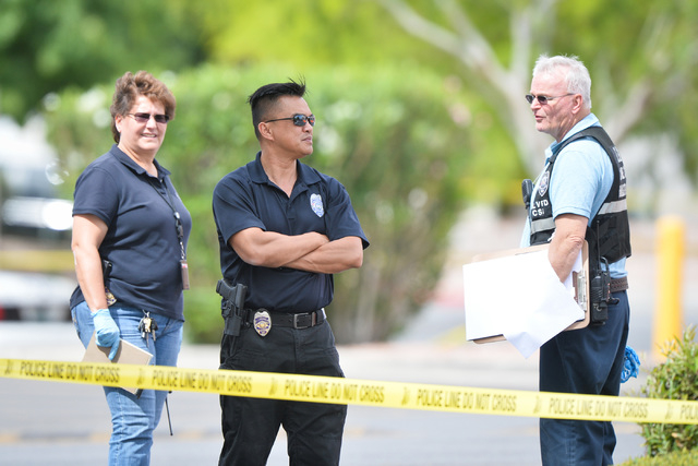 North Las Vegas police stand outside of a day care center where two people died in a shooting at Martin Luther King Boulevard and Ramble Ridge Way on Thursday, May 5, 2016. (Brett Le Blanc/Las Veg ...
