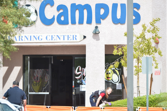North Las Vegas police investigate the scene of a deadly shooting at a day care center at Martin Luther King Boulevard and Ramble Ridge Way on Thursday, May 5, 2016. (Brett Le Blanc/Las Vegas Revi ...