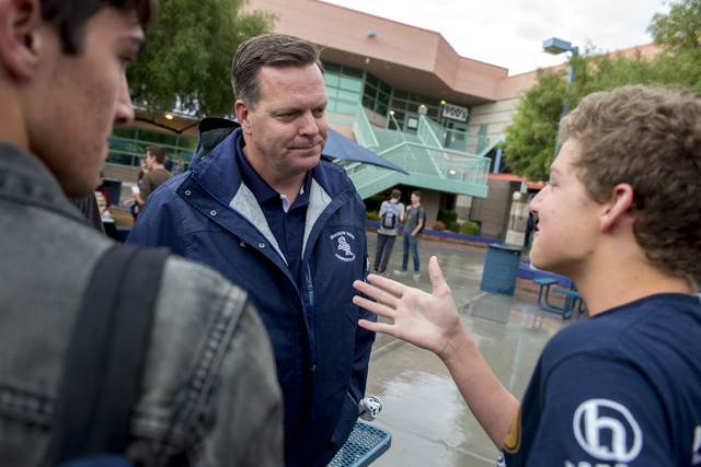 Principal Travis Warnick talks with students during their lunch at Shadow Ridge High School in Las Vegas May 6, 2016. Warnick was named a finalist of Varsity Brands 2016 School Spirit Awards Princ ...